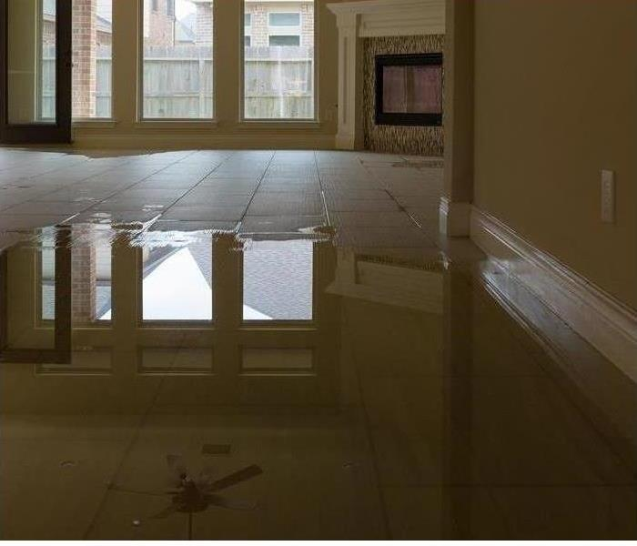 A floor soaked with water in a home